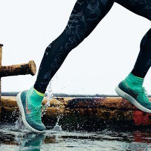 Nike Women's LunarEpic FlyKnit Shield Running Shoe